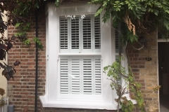 Sash window with plantation shutters