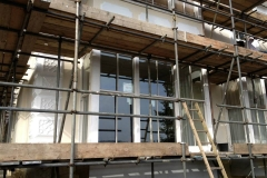 Sash window repair house with scaffolding