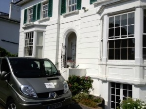 Sash Window Experts van in front of period house