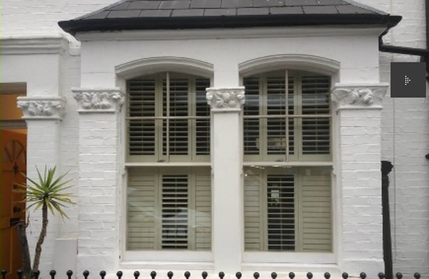 Sash Window with plantation shutters on Victorian villa