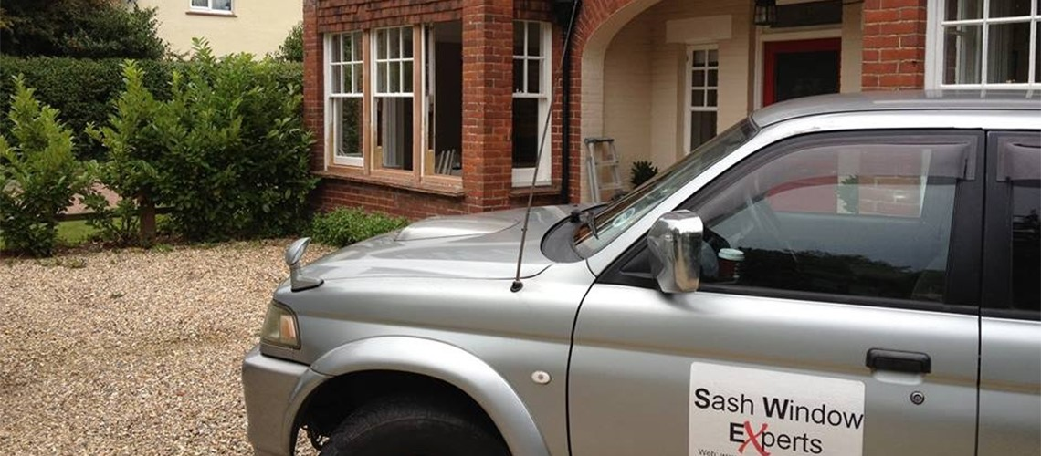 Period house with sash windows and Sash Window Experts van parked outside