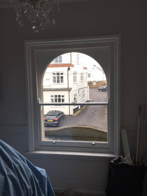 Beautiful curved headed hardwood double glazed replica sashes, after work completed