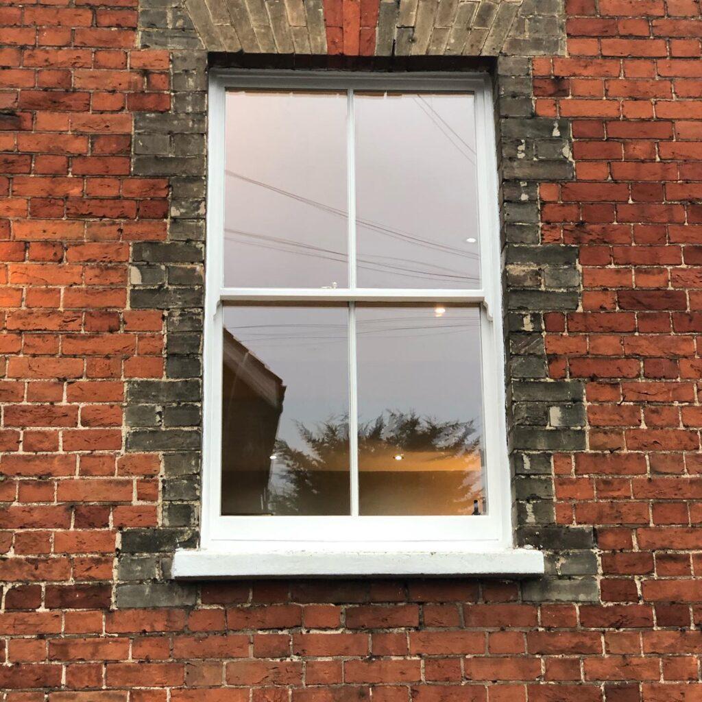 Installation of new hard wood sash windows with double glazed laminated glass 1