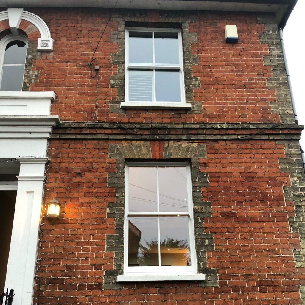 Installation of new hard wood sash windows with double glazed laminated glass 2